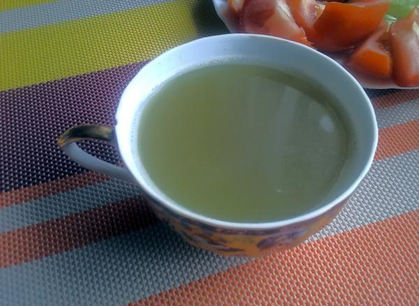 отвар створок фасоли в чашке